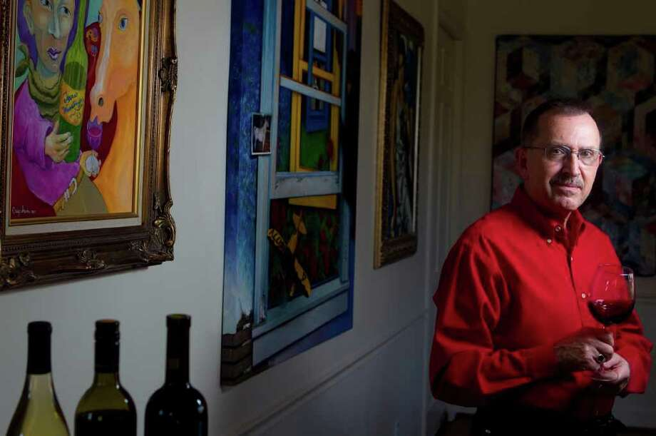 Russell Kane relaxes with a glass of wine at his home. Kane is a blogger and author, having written The Wine- slinger Chronicles, which explores Texas growers and winemakers and their determination to succeed. Photo: Cody Duty / © 2011 Houston Chronicle