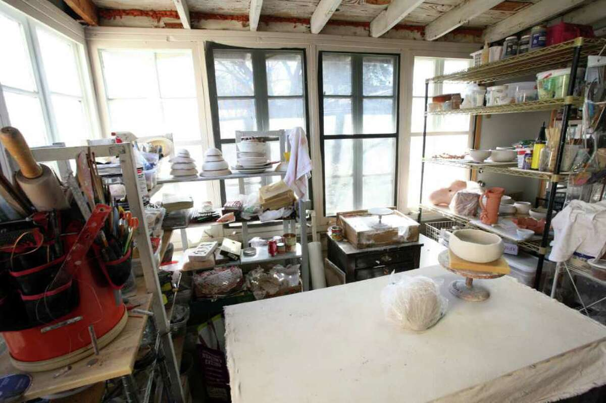 Sarah Shore turned the enclosed back porch into a multipurpose space that includes her ceramics studio.