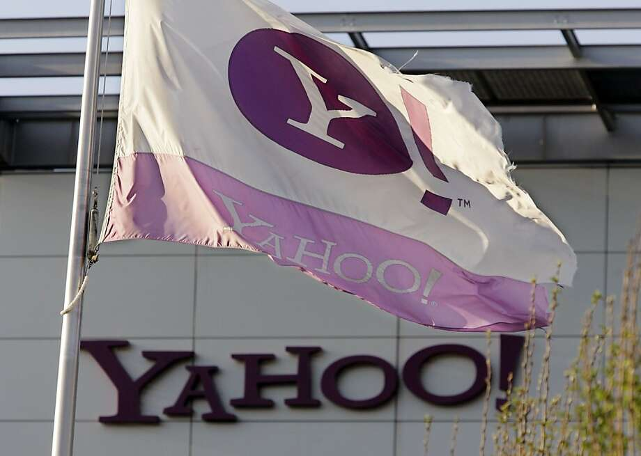 The Yahoo flag flies at Yahoo headquarters in Sunnyvale, Calif., Monday, April 20, 2009. Yahoo Inc. confirmed Tuesday that it would cut 675 jobs, or 5 percent of its workforce. Yahoo's first-quarter profit fell 78 percent to $118 million. (AP Phoito/Paul Sakuma) Photo: Paul Sakuma, AP
