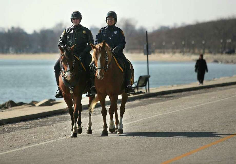 Mounted police officers Erick Norton, left, and Tom Choothesa patrol Seaside Park in Bridgeport on Tuesday, February 7, 2012. Photo: Brian A. Pounds / Connecticut Post