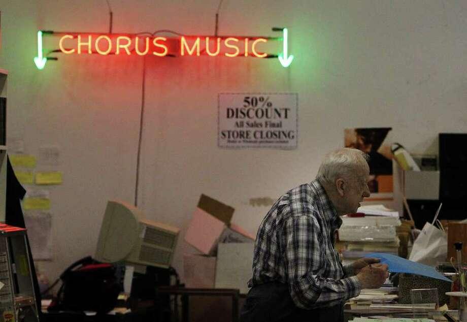 Southern Music Co. employee Maurice Mazel helps a customer on Tuesday, Feb. 7, 2012. Photo: Kin Man Hui, San Antonio Express-News / San Antonio Express-News