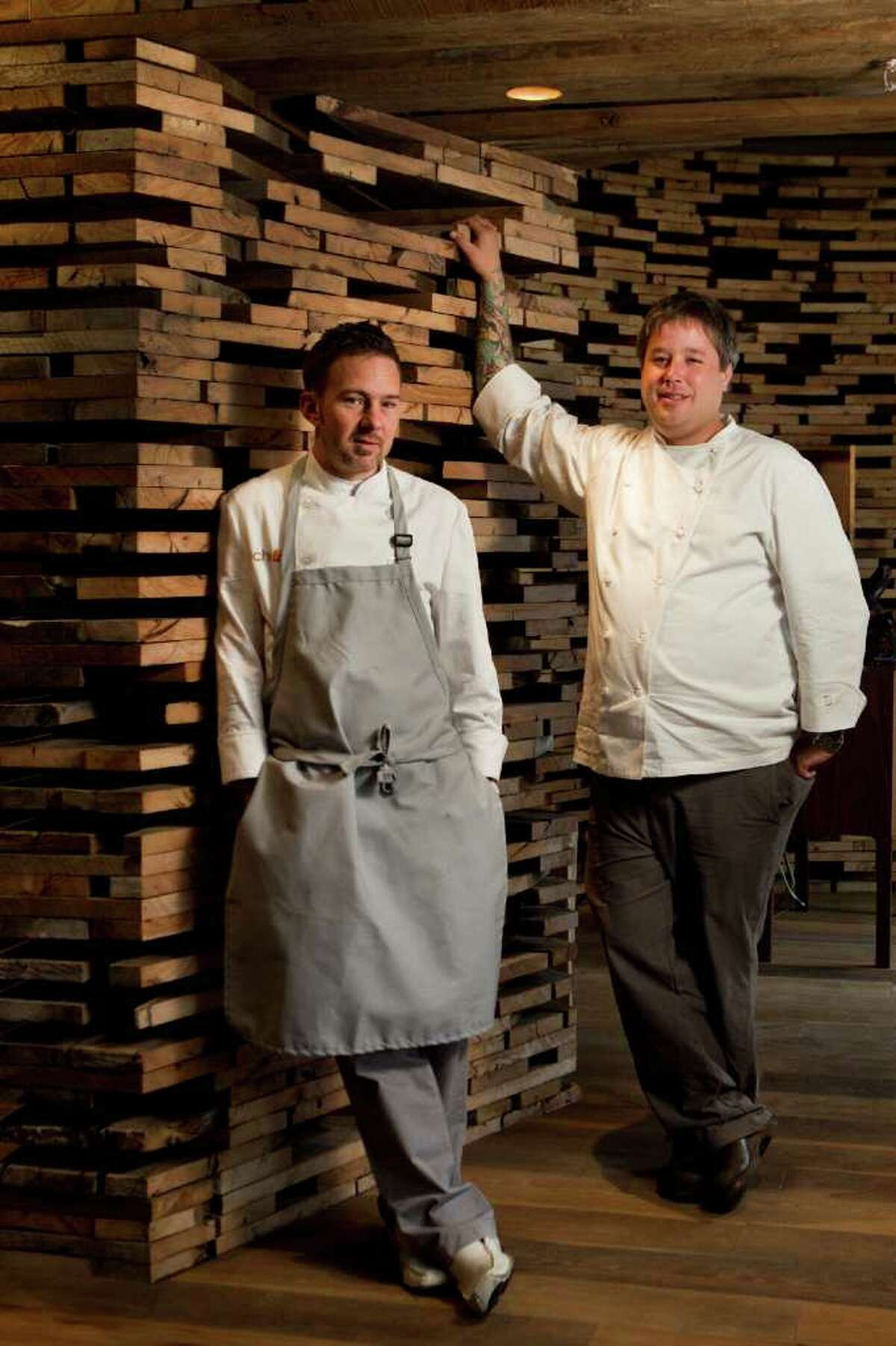 Tyson Cole, left, chef and owner, and Philip Speer, director of culinary operations, pose for a portrait at Uchi Thursday, Feb. 2, 2012, in Houston. ( Brett Coomer / Houston Chronicle )