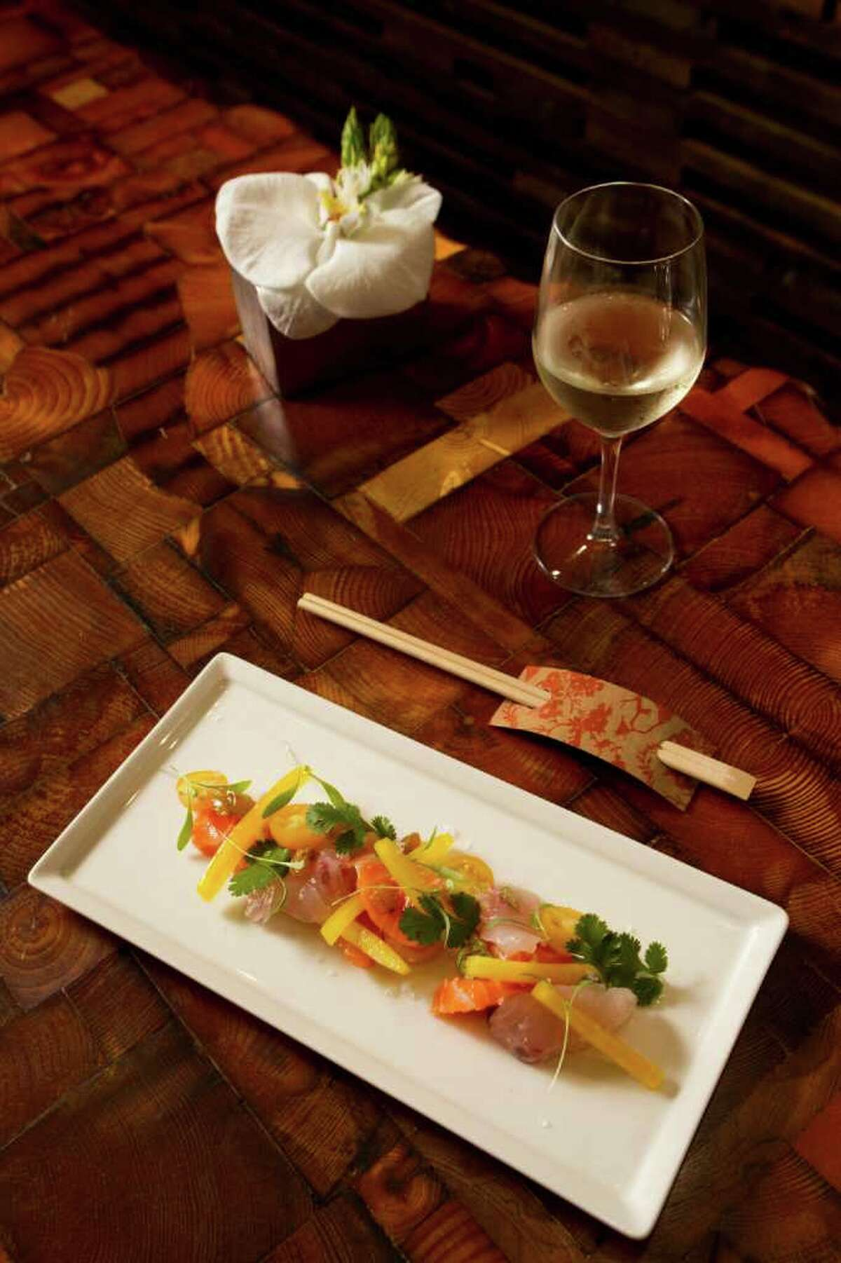 Uchiviche: salmon, striped bass, tomato, bell pepper, garlic and cilantro, is shown at Uchi Thursday, Feb. 2, 2012, in Houston. ( Brett Coomer / Houston Chronicle )