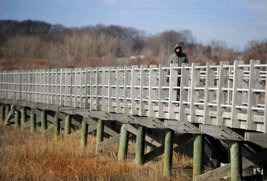 David Hatch, of Milford, strolls the boardwalk Tuesday, Feb. 7, 2012 at Silver Sands State Park in Milford, Conn. Photo: Autumn Driscoll / Connecticut Post