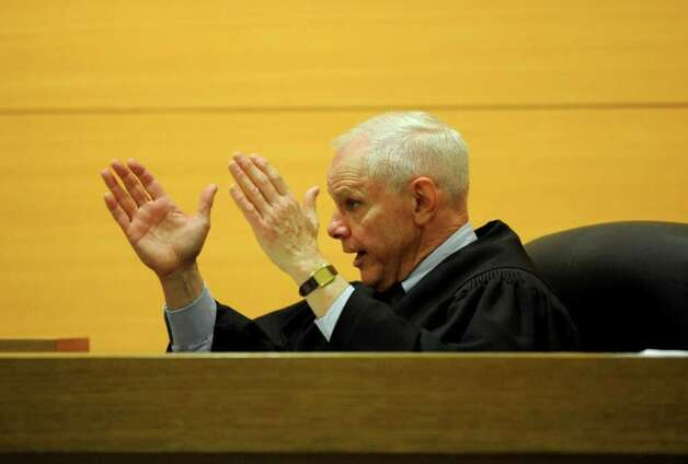 Judge Richard Comerford gives instructions to the jury in the case against self-represented Sheila Davalloo in State Superior Court in Stamford on Tuesday, February 7, 2012. Davalloo is charged in the 2002 murder of Anna Lisa Raymundo. Photo: Lindsay Niegelberg / Stamford Advocate