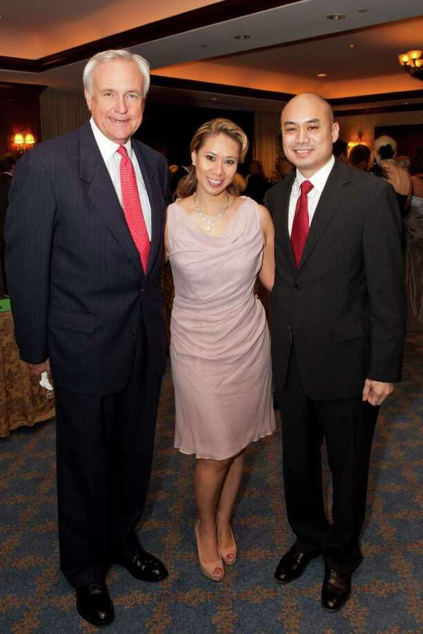 Bill King, left, and event co-chairs Lauren and Norman Nolasco Photo: Bruce Bennett / Houston Chronicle