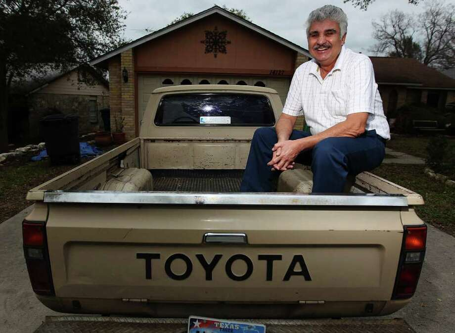 Jimmy Gonzales owns a 1982 Toyota pickup that he estimates has between 400,000 and 500,000 miles on it. He bought the vehicle  from a neighbor in 1988 for about $1,900. Photo: Kin Man Hui, San Antonio Express-News / San Antonio Express-News