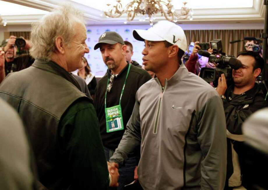 "Tiger Woods (right) greets actor and ""Caddyshack"" star Bill Murray after a news conference at the AT&T Pebble Beach National Pro-Am in Pebble Beach,  Calif., on Tuesday. Photo: AP"