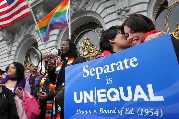 Monica Chacon and girlfriend Breana Hansen celebrate outside of City Hall, Tuesday February 7, 2012,  after the 9th U.S. Circuit Court of Appeals ruled that the voter approved Proposition 8 measure violates the civil rights of gays and lesbians.