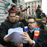 Bob Horowitz (left to right) and Rev. Will McGarvey, East County Shared Ministry Pastor read the Ninth U.S. Circuit Court of Appeals ruling as Proposition 8 supporters react outside the James R. Browning United States Courthouse after a federal appeals court declared California's ban on same-sex marriage unconstitutional on Tuesday, February 7, 2012 in San Francisco, Calif. A federal appeals court declared California's ban on same-sex marriage unconstitutional today, saying a state can't revoke gay rights solely because a majority of its voters disapprove of homosexuality.