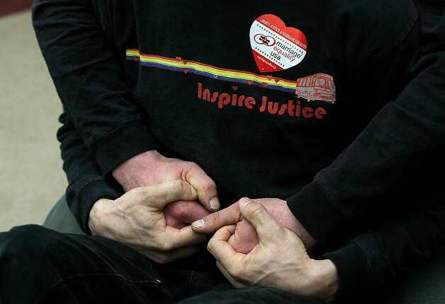 A same-sex couple holds hands during a press conference at San Francisco City Hall on February 7, 2012 in San Francisco, California. A three-judge panel of the 9th U.S. Circuit Court of Appeals ruled that the voter-approved Proposition 8 measure violates the civil rights of gay men and lesbians. Photo: Justin Sullivan, Getty Images