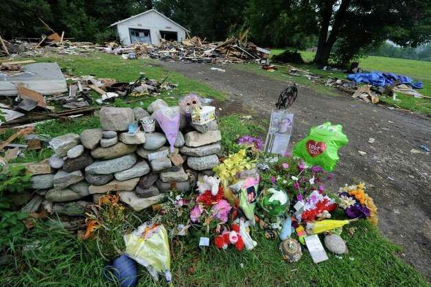A memorial at the site of a July 2011 house explosion on Route 29 in Salem. Six people died as a result of the explosion. (Skip Dickstein / Times Union archive) Photo: SKIP DICKSTEIN