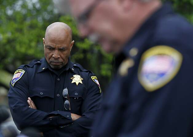 Newark police Cmdr. Renny Lawson (left) listens as Cmdr Robert Douglas provide information about a shooting which wounded a federal officer in front of his home in Newark, Calif. on Tuesday, Feb. 7, 2012. Photo: Paul Chinn, The Chronicle
