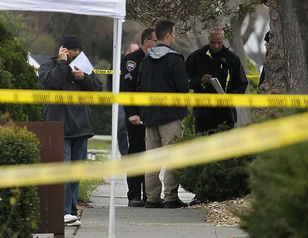Police investigators gather evidence at the scene following a shooting which wounded a federal officer in front of his home in Newark, Calif. on Tuesday, Feb. 7, 2012. Photo: Paul Chinn, The Chronicle