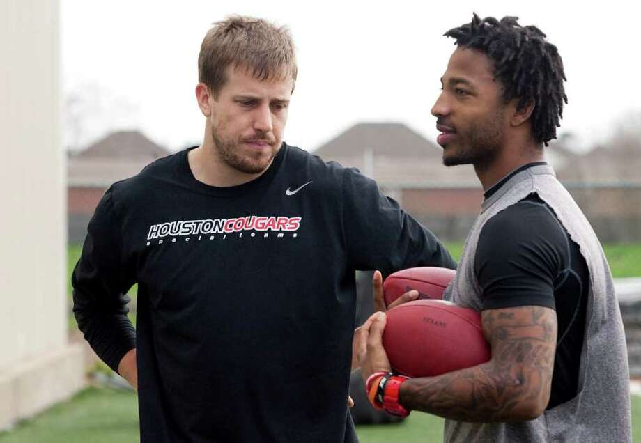 University of Houston quarterback Case Keenum and wide receiver Patrick Edwards work out in preparation for the NFL draft at the Plex fitness complex on Monday, January 30, 2012 in Stafford, TX. Photo: J. Patric Schneider, For The Chronicle / Houston Chronicle