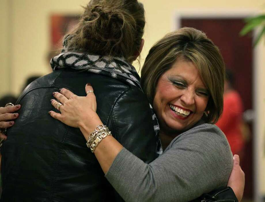 Herlinda Bourassa (right), Quest College Beauty Health and Wellness director, greets Joan Cadena, whose husband is being treated at Brooke Army Medical Center. Photo: BOB OWEN, San Antonio Express-News / © 2012 San Antonio Express-News