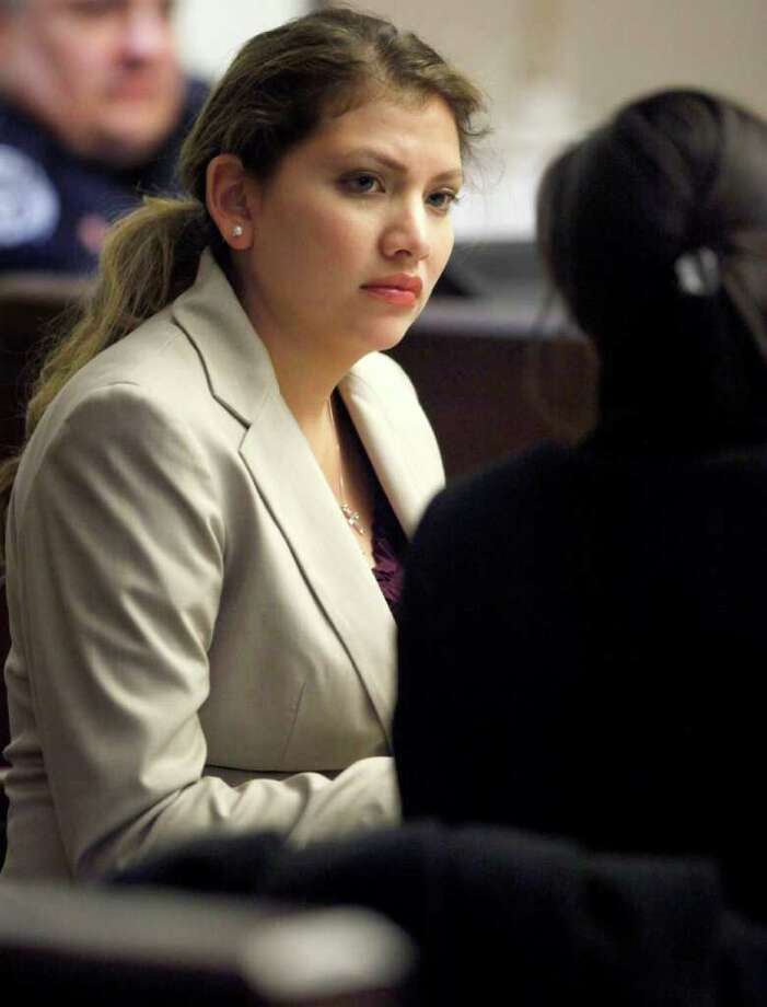Jenny Ybarra talks to one of her attorneys in 437th District Court at the Cadena Reeves Justice Center during her intoxication manslaughter trial for the death of Erica Nicole Smith. Photo: William Luther, San Antonio Express-News / © 2012 SAN ANTONIO EXPRESS-NEWS