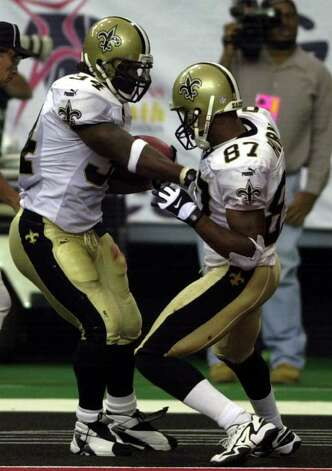 New Orleans Saints running back Ricky Williams (34) dances in the end zone with teammate Joe Horn (87) after scoring a touchdown in the second half Sunday, Oct. 22, 2000, in Atlanta. The Saints beat the Falcons 21-19. (AP Photo/Gregory Smith) Photo: GREGORY SMITH, AP/Express-News / AP