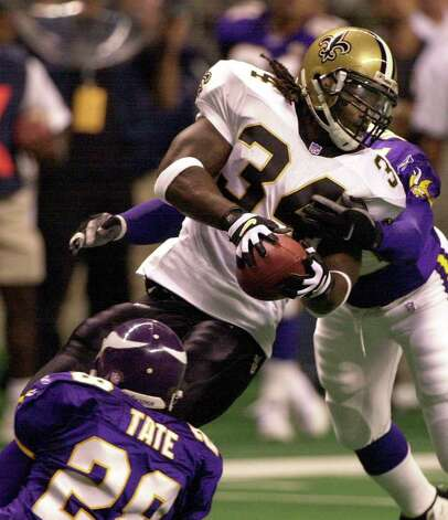 Saints running back Ricky Williams is tackled for a loss by Vikings defenders Robert Tate (28) and Lance Johnstone (51) during their game at the Alamodome. BAHRAM MARK SOBHANI/STAFF Photo: BAHRAM MARK SOBHANI, AP/Express-News / EN