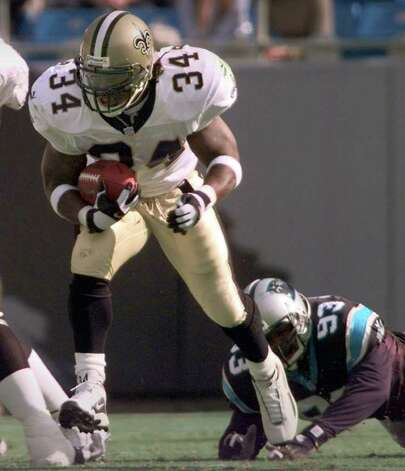 New Orleans Saints' Ricky Williams (34) breaks the tackle of Carolina Panthers' Michael Rucker (93) in the second quarter at Ericsson Stadium in Charlotte, N.C., Sunday Nov. 12, 2000. Williams hit the 1,000-yard rushing mark, then broke his ankle Sunday in the New Orleans Saints' 20-10 victory over the Carolina Panthers.(AP Photo/Rusty Burroughs) Photo: RUSTY BURROUGHS, AP/Express-News / AP