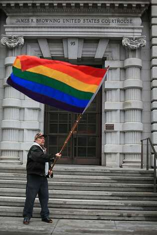 Bob Sodervick of San Francisco waves a rainbow flag outside of the James R. Browning United States Courthouse as he demonstrates with others while waiting to hear the Ninth U.S. Circuit Court of Appeals ruling on Tuesday, February 7, 2012 in San Francisco, Calif. A federal appeals court declared California's ban on same-sex marriage unconstitutional today, saying a state can't revoke gay rights solely because a majority of its voters disapprove of homosexuality. Photo: Lea Suzuki, The Chronicle