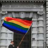 Bob Sodervick of San Francisco waves a rainbow flag outside of the James R. Browning United States Courthouse as he demonstrates with others while waiting to hear the Ninth U.S. Circuit Court of Appeals ruling on Tuesday, February 7, 2012 in San Francisco, Calif. A federal appeals court declared California's ban on same-sex marriage unconstitutional today, saying a state can't revoke gay rights solely because a majority of its voters disapprove of homosexuality.