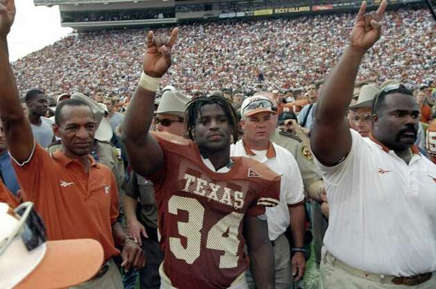 Running back Ricky Williams #34 of the Texas Longhorns celebrates during the game against the Texas A&M Aggies at the Memorial Stadium in Austin, Texas. The Longhorns defeated the Aggies 26-24. Photo: Brian Bahr, AP/Express-News / Getty Images North America