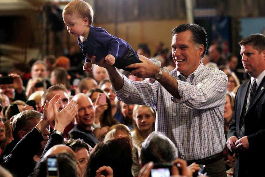 Republican presidential candidate, former Massachusetts Gov. Mitt Romney holds One-year-old Madison