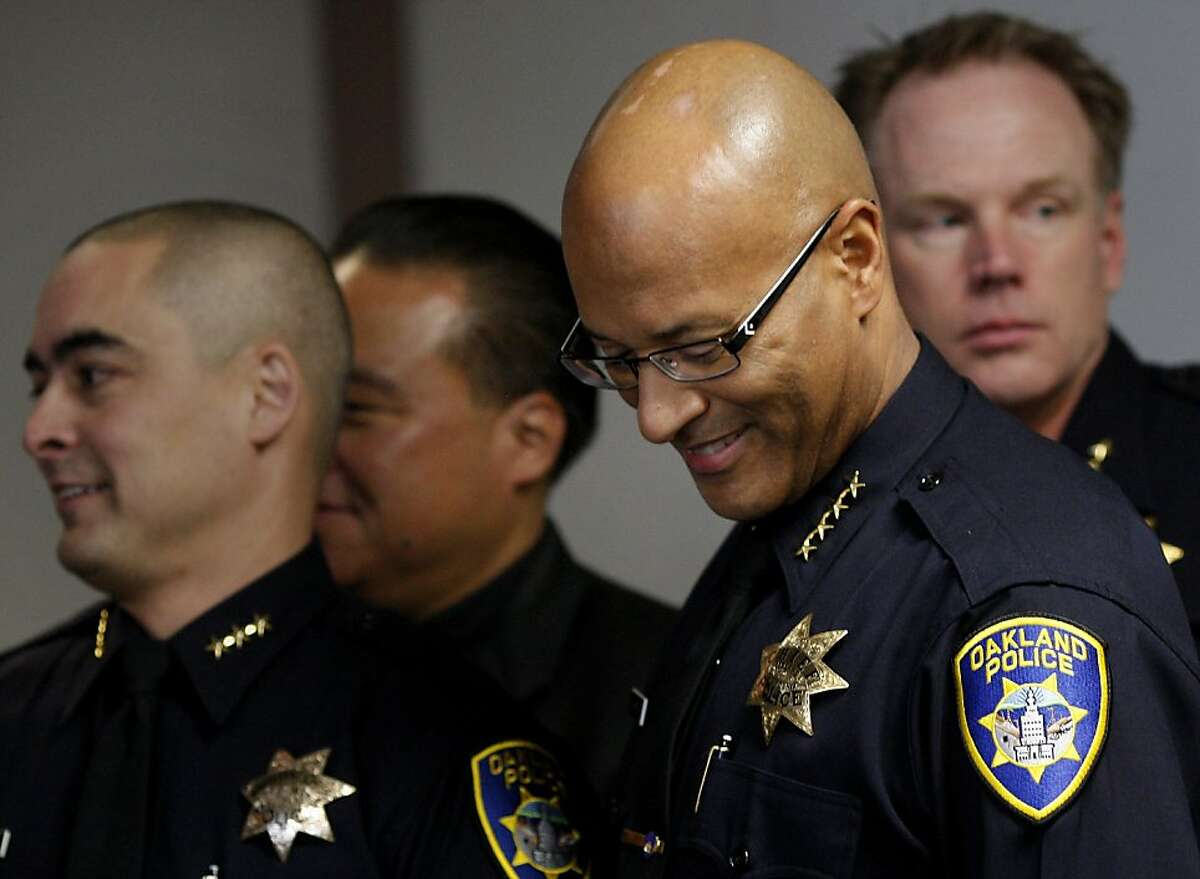 Police Chief Howard Jordan (right) smiled as he stood with members of his command staff. Oakland Police Chief Howard Jordan held a press conference with members of the community to talk about the recent rash of violence in the city Tuesday February 7, 2012.