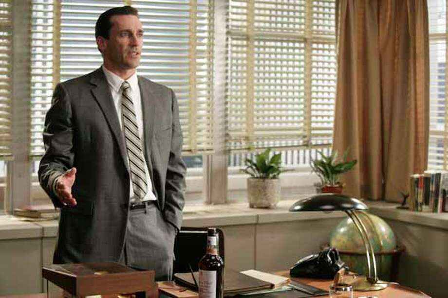 "In this 2006 photo provided by AMC, actor John Hamm portrays Don Draper, the creative director of the Sterling Cooper Advertising Agency in the AMC dramatic series ""Mad Men."" Photo: Craig Blankenhorn, Ho / AMC"