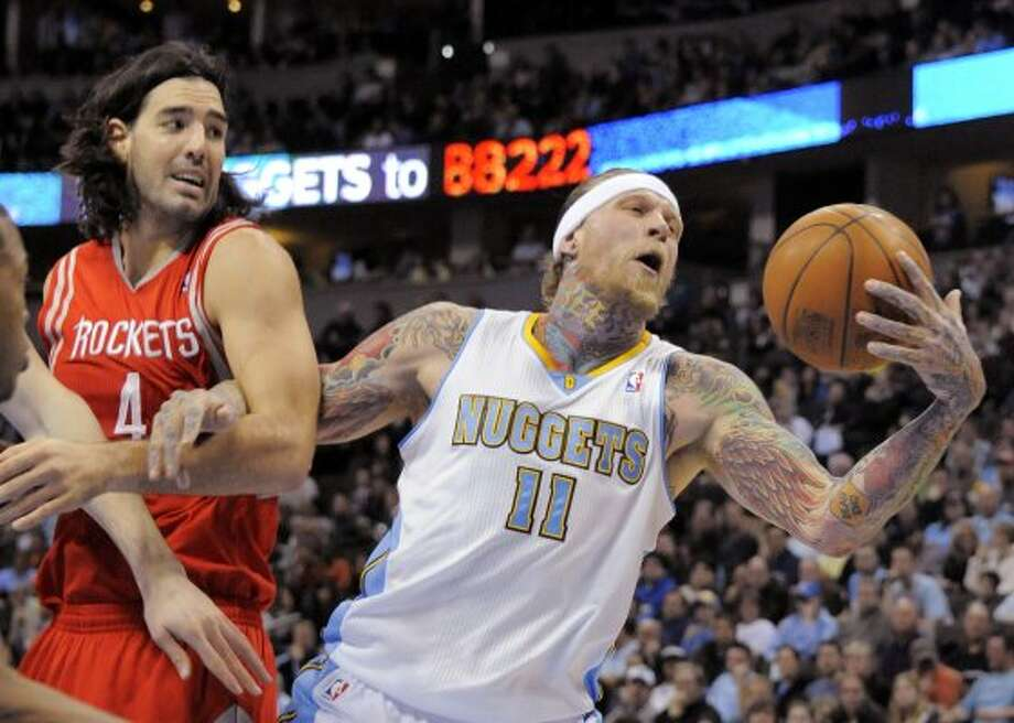 Nuggets center Chris Andersen (11) grabs a rebound against Rockets forward Luis Scola (4) during the second quarter. (Jack Dempsey / Associated Press)