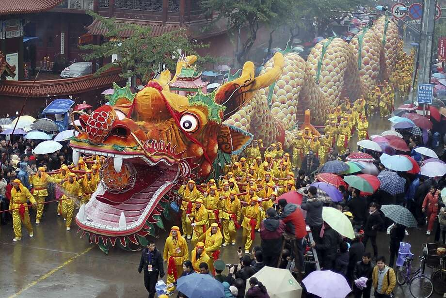 In this Monday, Feb. 6, 2012 photo, people watch a dragon parade during Lantern Festival celebrations at Aojiang town in Wenzhou, in eastern China's Zhejiang province. The festival marks the final day of the Spring Festival, the annual celebration of the Chinese Lunar New Year. (AP Photo) CHINA OUT Photo: Associated Press