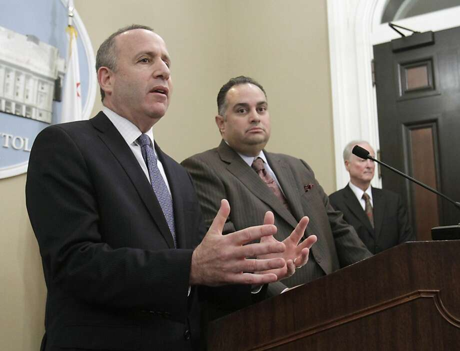 State Senate President Pro Tem Darrell Steinberg, D-Sacramento, left, discusses the lawsuit he and Assembly Speaker John Perez, D-Los Angeles, center, filed against state Controller John Chiang over last year's state budget, during a Capitol news conference in Sacramento, Calif., Tuesday, Jan. 24, 2012.  The Legislative leaders are suing the controller for blocking lawmakers paychecks when he decided they had not approved a balance budget by the June 15th deadline.  Both Perez and Steinberg say they don't want their money back, but they do want the courts to rule that Controller Chiang violated the constitutional separation of powers when he with held lawmakers pay. At right is retired appellate California Appellate Court Judge Arthur Scotland who is representing Perez and Steinberg. Photo: Rich Pedroncelli, Associated Press