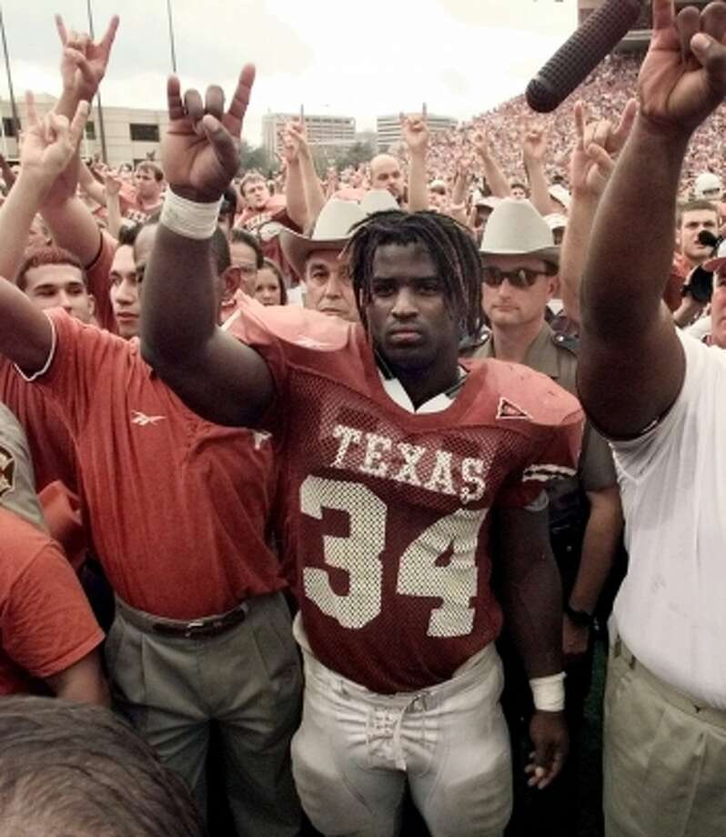 Among Ricky Williams' NCAA records were career rushing yards (6,279), all-purpose yards (7,206), rushing TDs (72), total TDs (75), scoring (452 points), games with a TD (33), games with two or more TDs (21), yards per rush (6.2/min. 780 carries) and 200-yard games (11).  (ERIC GAY / AP)