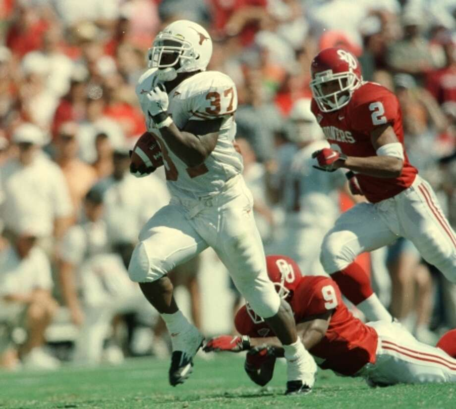 University of Texas running back Ricky Williams scores against Oklahoma on Oct. 11, 1998, in a 34-3 Longhorns victory. (Kevin Fujii / Houston Chronicle)