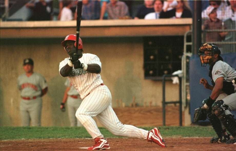 Ricky Williams also found the time to play a little baseball, here batting for the Batavia Muckdogs against the Jamestown Jammers on June 19, 1998, at Dwyer Stadium in Batavia, N.Y. Williams played four seasons of minor-league baseball, from 1995-1998. He batted .283 in 1998 with Batavia, his final season. (JOHN HICKEY / JOHN HICKEY   1998)