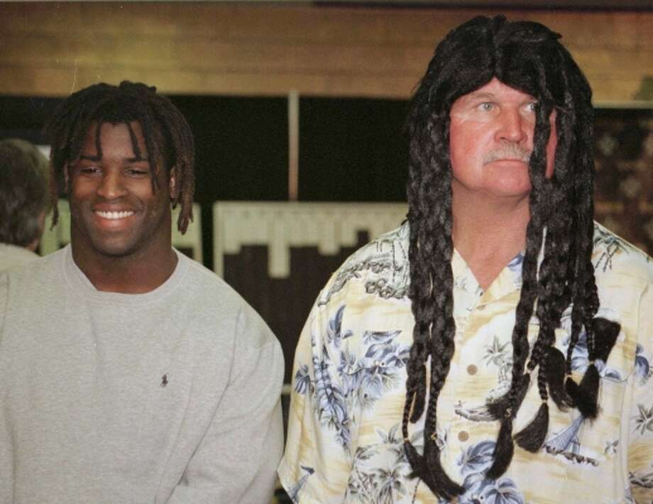 "Ricky Williams and coach Mike Ditka meet the media at the New Orleans Saints camp Sunday, April 18, 1999, in Kenner, La. Ditka donned shoulder-length dreadlocks to welcome Williams, whom he traded his entire draft away for, to the Saints. ""Seeing this kind of a reaction really humbles me.  All these people think that I'm the best player on the team, and I'm probably not even in the top 10,"" Williams said that day. (JUDI BOTTONI / AP)"