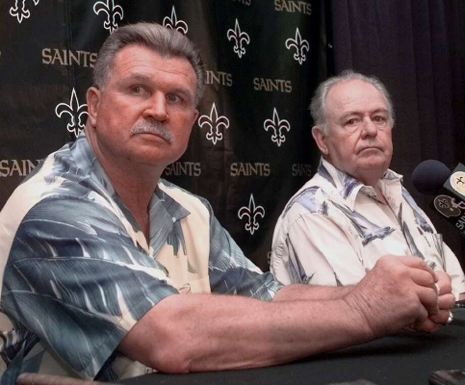 New Orleans Saints coach Mike Ditka, left, and team owner Tom Benson discuss the acquisition of Heisman Trophy winner Ricky Williams. The Saints traded first, third, fourth, fifth, sixth and seventh round picks this year and a first- and third-rounder in 2000 to the Redskins to get Williams. (BILL HABER / AP)