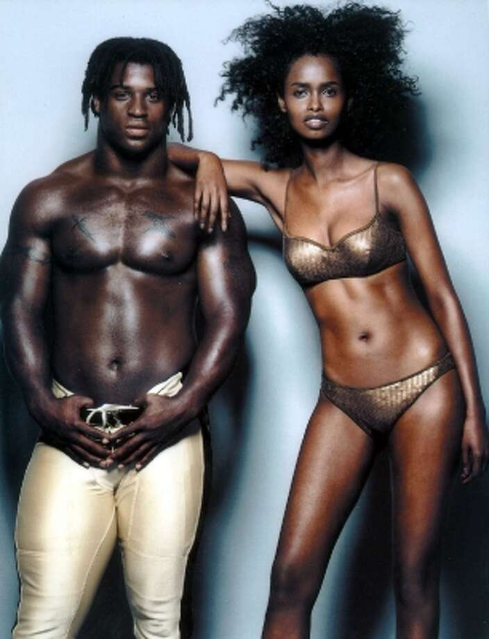 Ricky Williams posed with fashion model Kadra Ahmed-Omar in the  2000 Sports Illustrated swimsuit issue. (AP)