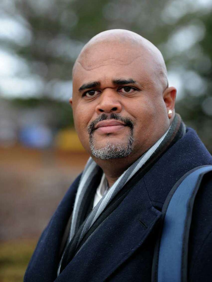 Wayne Spence, a Long Island parole officer, will received $50,000 from the state under a settlement in his federal civil rights lawsuit. Spence was targeted by parole officials for a second job after he testified at an Assembly hearing in 2006 about problems in the agency. (Skip Dickstein / Times Union)