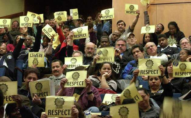 Parole officers holds up signs asking for respect in response to testimony by then Executive Director of the State Division of Parole Anthony Ellis. The hearing was held by the Assembly Standing Committee on Corrections on Tuesday, Jan. 31, 2006 at the Legislative Office Building in Albany, N.Y. (Paul Buckowski / Times Union) Photo: Paul Buckowski / Albany Times Union