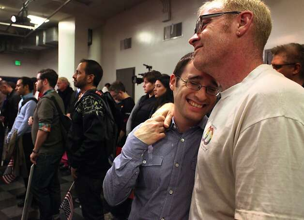 Ben Gertzfield (left) embraces fiance William Hamilton during a celebration at the Lesbian, Gay, Bisexual Transgender Community Center. Photo: Lacy Atkins, The Chronicle