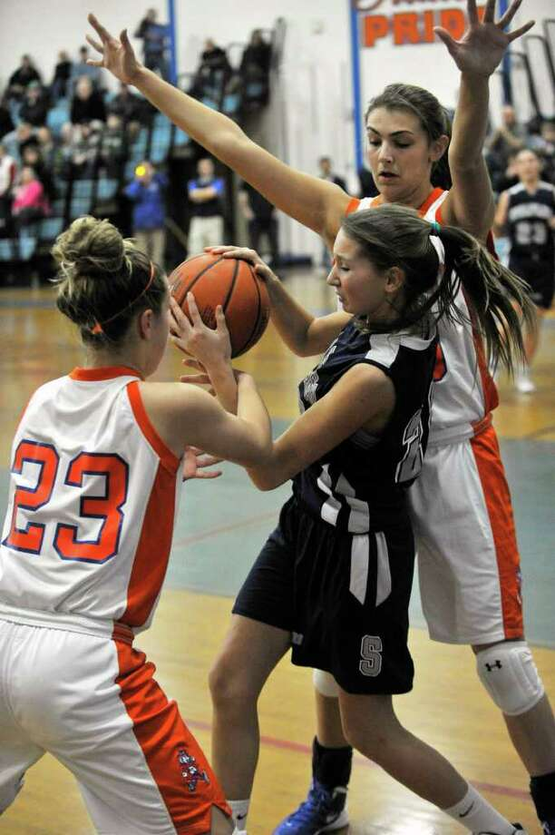 Staples' Nikki Bukovsky is double-teamed by Danbury's Rebecca Gartner, left, and Casey Smith during their game at Danbury High School on Tuesday, Feb. 7, 2012. Danbury won 45-35. Photo: Jason Rearick / The News-Times