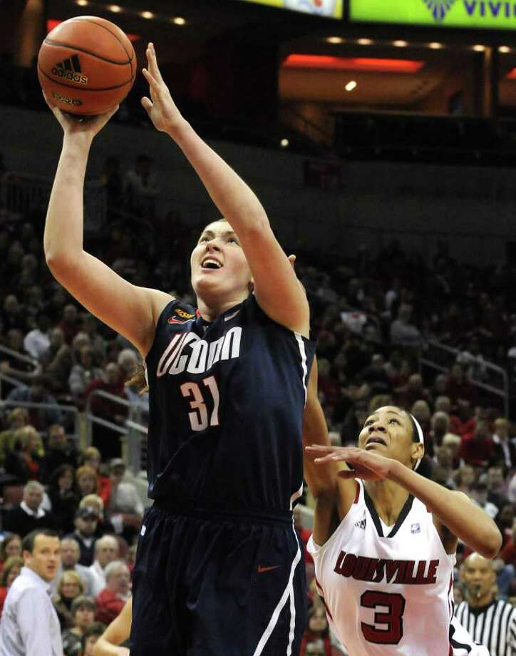 Connecticut's Stefanie Dolson (31) gets a shot off past Louisville's Sherrone Vails (3) during the first half of their NCAA  college basketball game Tuesday, Feb. 7, 2012 in Louisville, Ky.  (AP Photo/Timothy D. Easley) Photo: Timothy D. Easley, Associated Press / Timothy D. Easley