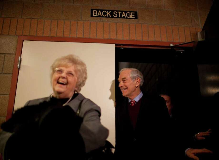 Republican presidential candidate, U.S. Rep. Ron Paul, of Texas, leaves the stage after addressing voters attending their caucuses at Maple Grove Junior High School in Maple Grove, Minn., Tuesday night, Feb. 7, 2012. Photo: Jeff Wheeler, Associated Press / The Star Tribune