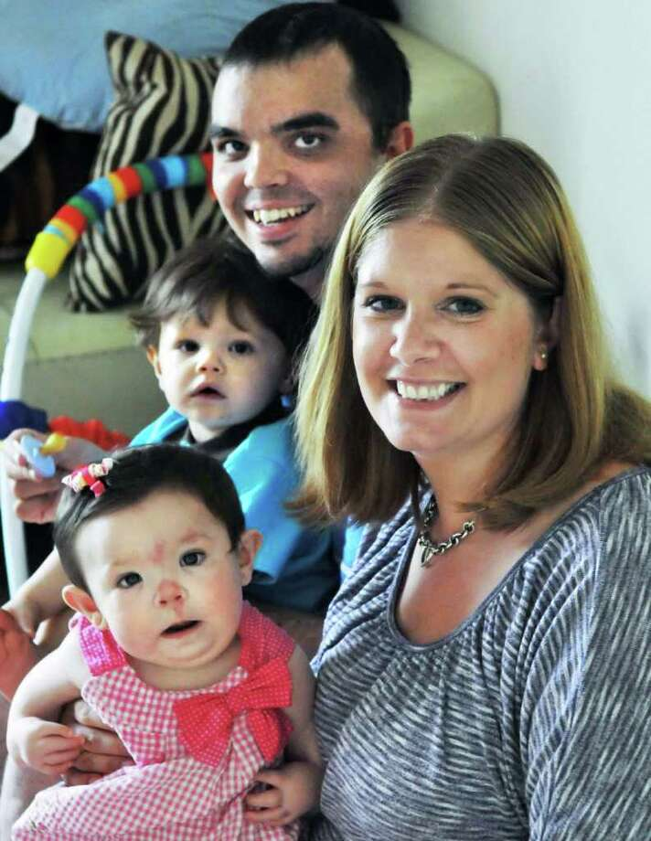 Tony, left, and Margie  Cottone with their children, 21-month-old  Jayden, and 7-month-old Alexis at their South Glens Falls home in June 2011.  (John Carl D'Annibale / Times Union archive) Photo: John Carl D'Annibale / 00013363A