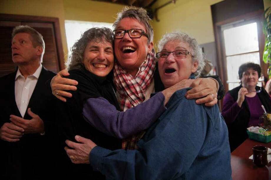 Partners Ellen Pontac, left, and Shelly Bailes, right, hug Tina Reynolds, on news of the ruling Tuesday. Photo: Renee C. Byers / Sacramento Bee