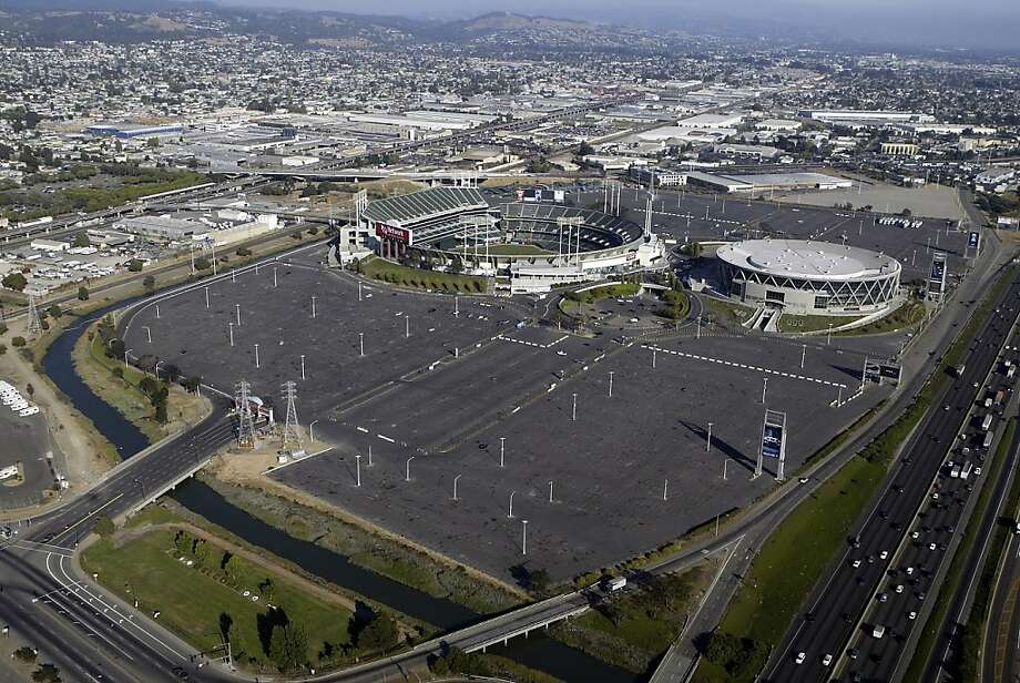 Oakland Coliseum and Oracle Arena with parking lots. Photo: Darryl Bush, The Chronicle