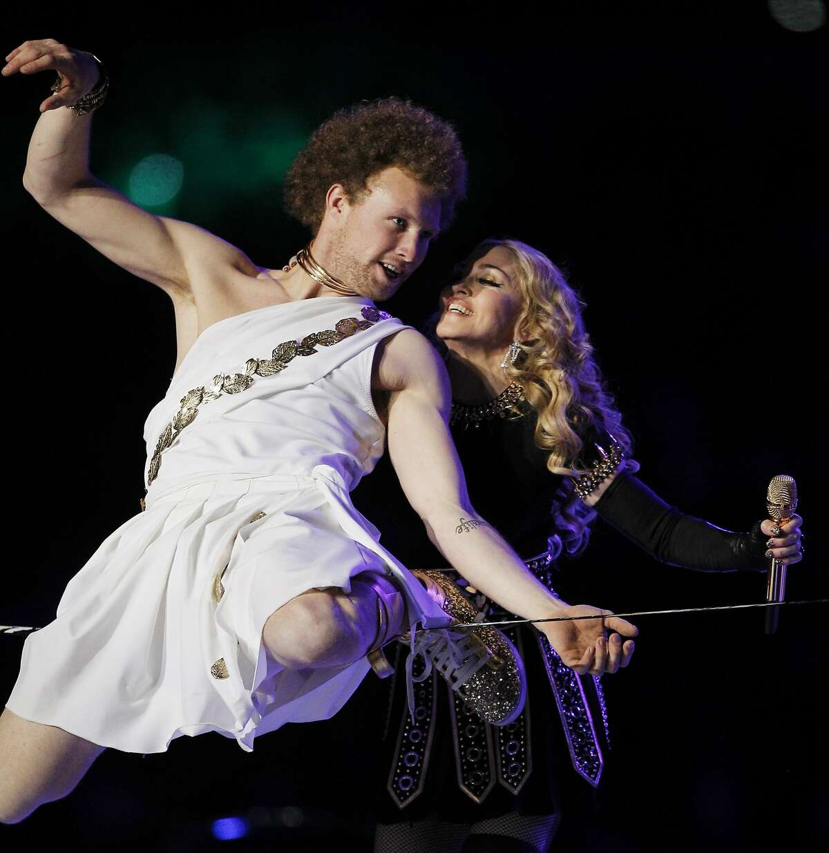 Madonna, right, performs during halftime of the NFL Super Bowl XLVI football game between the New York Giants and the New England Patriots Sunday, Feb. 5, 2012, in Indianapolis. (AP Photo/Paul Sancya)