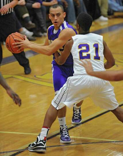 CBA's Chaz Lott looks to pass the ball around Isiah Dobere of Troy during a basketball game on Tuesd